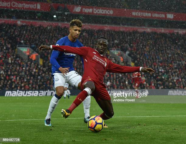 Sadio Mane of Liverpool competes with Mason Holgate of Everton during the Premier League match between Liverpool and Everton at Anfield on December...