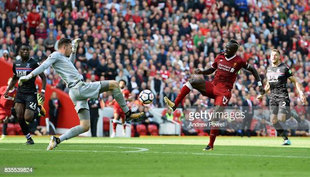 Sadio Mane of Liverpool competes with Wayne Hennessey Crystal Palace during the Premier League match between Liverpool and Crystal Palace at Anfield...