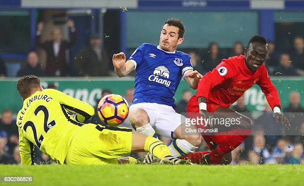 Sadio Mane of Liverpool is foiled by Leighton Baines and Maarten Stekelenburg of Everton during the Premier League match between Everton and...