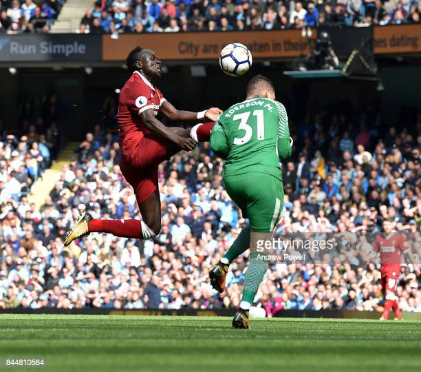 Sadio Mane of Liverpool kicks Ederson Moraes of Man City in the face and gets sent off during the Premier League match between Manchester City and...