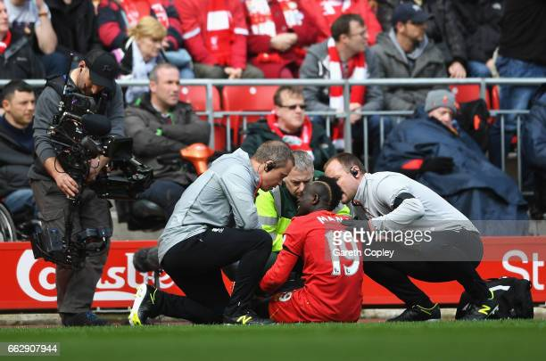 Sadio Mane of Liverpool receives treatment from the medical team during the Premier League match between Liverpool and Everton at Anfield on April 1...