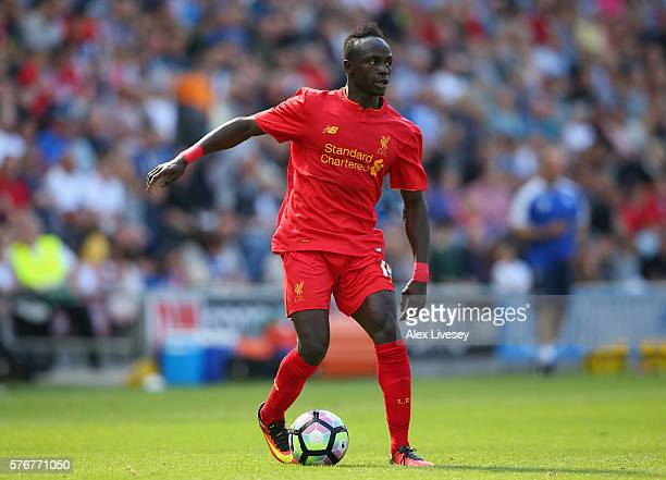 Sadio Mane of Liverpool runs with the ball during a preseason friendly between Wigan Athletic and Liverpool at JJB Stadium on July 17 2016 in Wigan...
