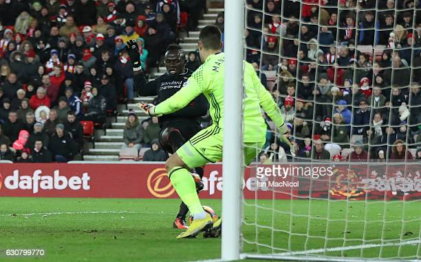 Sadio Mane of Liverpool scores during the Premier League match between Sunderland and Liverpool at Stadium of Light on January 2 2017 in Sunderland...