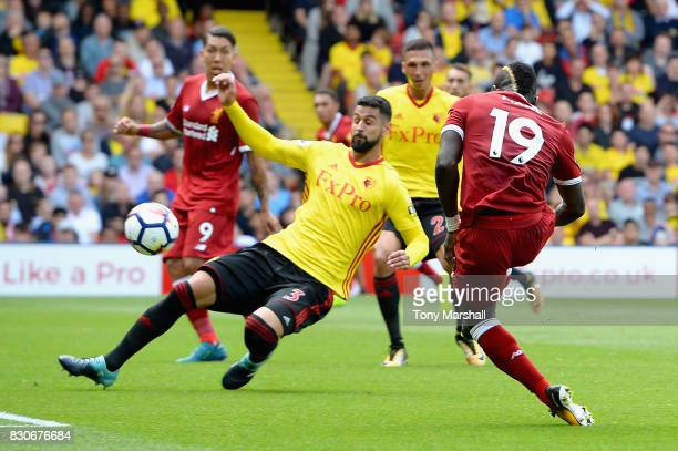 Sadio Mane of Liverpool scores his sides first goal during the Premier League match between Watford and Liverpool at Vicarage Road on August 12 2017...