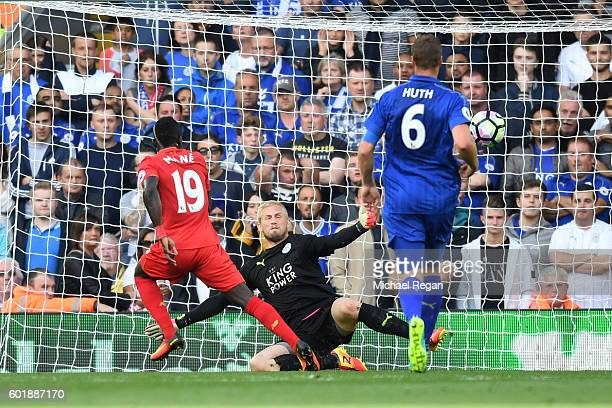 Sadio Mane of Liverpool scores his sides second goal past Kasper Schmeichel of Leicester City during the Premier League match between Liverpool and...