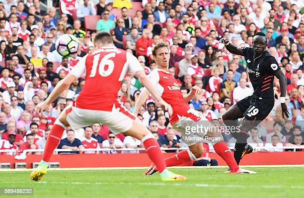 Sadio Mane of Liverpool scores his team's fourth goal during the Premier League match between Arsenal and Liverpool at Emirates Stadium on August 14...
