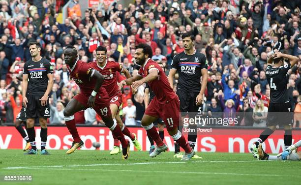 Sadio Mane of Liverpool scores The Opener and Celebrates during the Premier League match between Liverpool and Crystal Palace at Anfield on August 19...