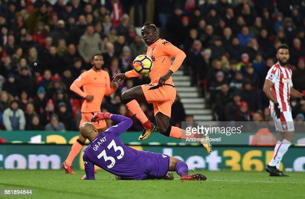 Sadio Mane of Liverpool Scores the Opener during the Premier League match between Stoke City and Liverpool at Bet365 Stadium on November 29 2017 in...