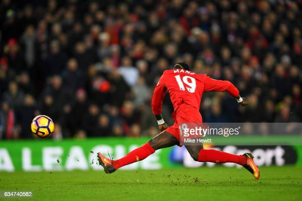 Sadio Mane of Liverpool scores the opening goal during the Premier League match between Liverpool and Tottenham Hotspur at Anfield on February 11...