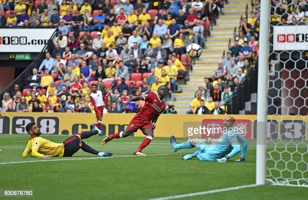 Sadio Mane of Liverpool Scores to put liverpool 11 during the Premier League match between Watford and Liverpool at Vicarage Road on August 12 2017...