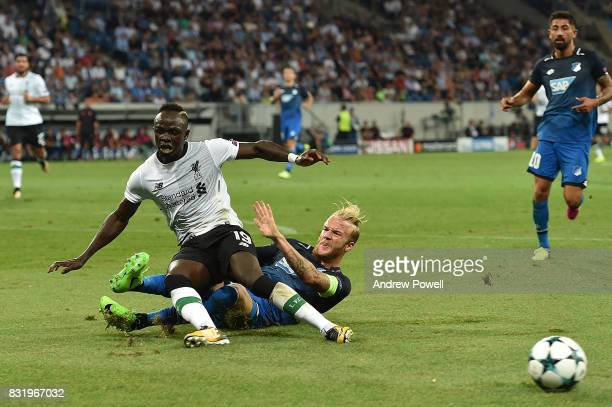 Sadio Mane of Liverpool with Kevin Vogt during the UEFA Champions League Qualifying PlayOffs Round First Leg match between 1899 Hoffenheim and...