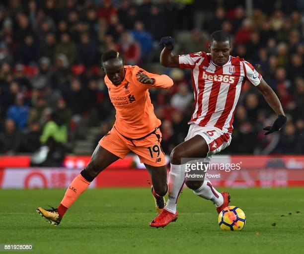Sadio Mane of Liverpool with Kurt Zouma of Stoke during the Premier League match between Stoke City and Liverpool at Bet365 Stadium on November 29...