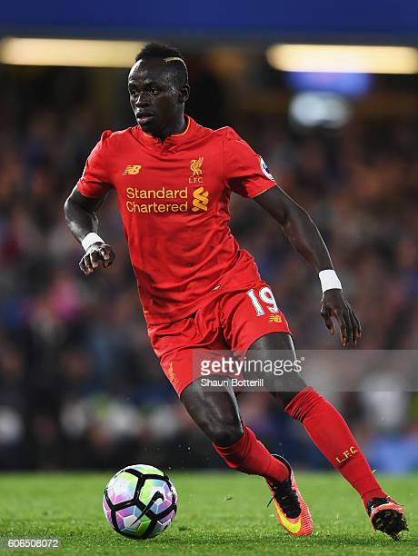 Sadio Mane of Liverpoolruns with the ball during the Premier League match between Chelsea and Liverpool at Stamford Bridge on September 16 2016 in...
