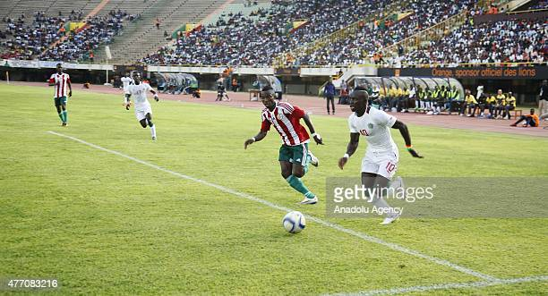 Sadio Mane of Senegal and Harerimana Rashia of Burundi vie for the ball during the 2017 Africa Cup of Nations qualification Group K game between...