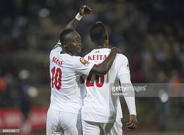 Sadio Mane of Senegal celebrates his goal and acknowledges the assist from Keita Balde during the Group B match between Senegal and Zimbabwe at Stade...