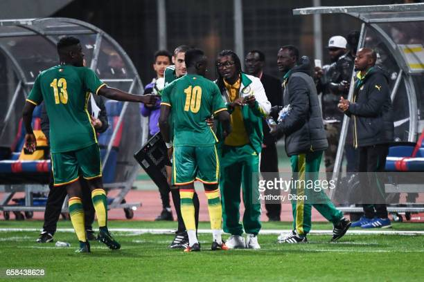 Sadio Mane of Senegal celebrates his goal with Aliou Cisse coach of Senegal during the friendly match between Senegal and Ivory Coast at Stade...