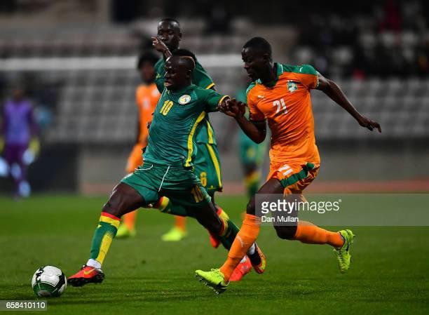 Sadio Mane of Senegal holds off Eric Bailly of the Ivory Coast during the International Friendly match between the Ivory Coast and Senegal at the...