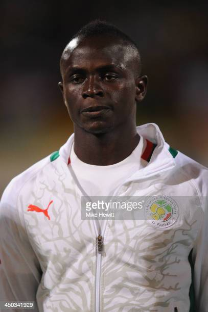 Sadio Mane of Senegal lines up for the National Anthem during the FIFA 2014 World Cup Qualifier Playoff Second Leg between Senegal and Ivory Coast at...