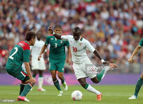 Sadio Mane of Senegal looks to get past Israel Jimenez of Mexico during the Men's Football Quarter Final match between Mexico and Senegal on Day 8 of...