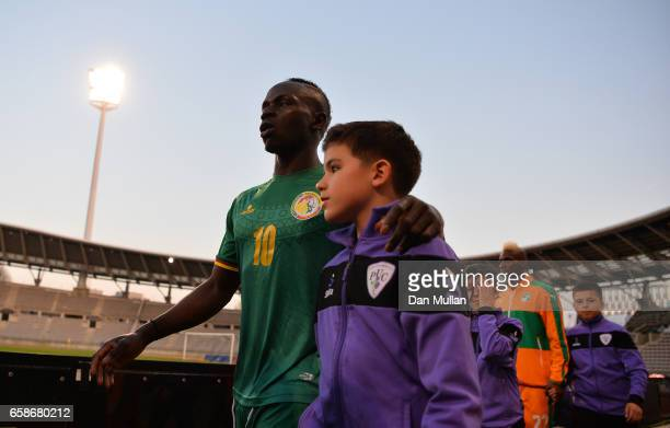Sadio Mane of Senegal makes his way onto the pitch prior to the International Friendly match between the Ivory Coast and Senegal at the Stade...