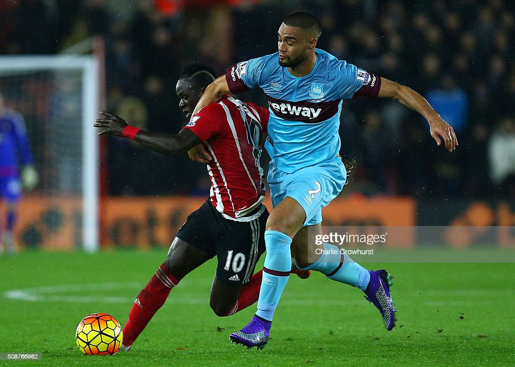 Sadio Mane of Southampton and <a gi-track='captionPersonalityLinkClicked' href=/galleries/search?phrase=Winston+Reid&family=editorial&specificpeople=5491819 ng-click='$event.stopPropagation()'>Winston Reid</a> of West Ham United battle for the ball during the Barclays Premier League match between Southampton and West Ham United at St Mary's Stadium on February 6, 2016 in Southampton, England.