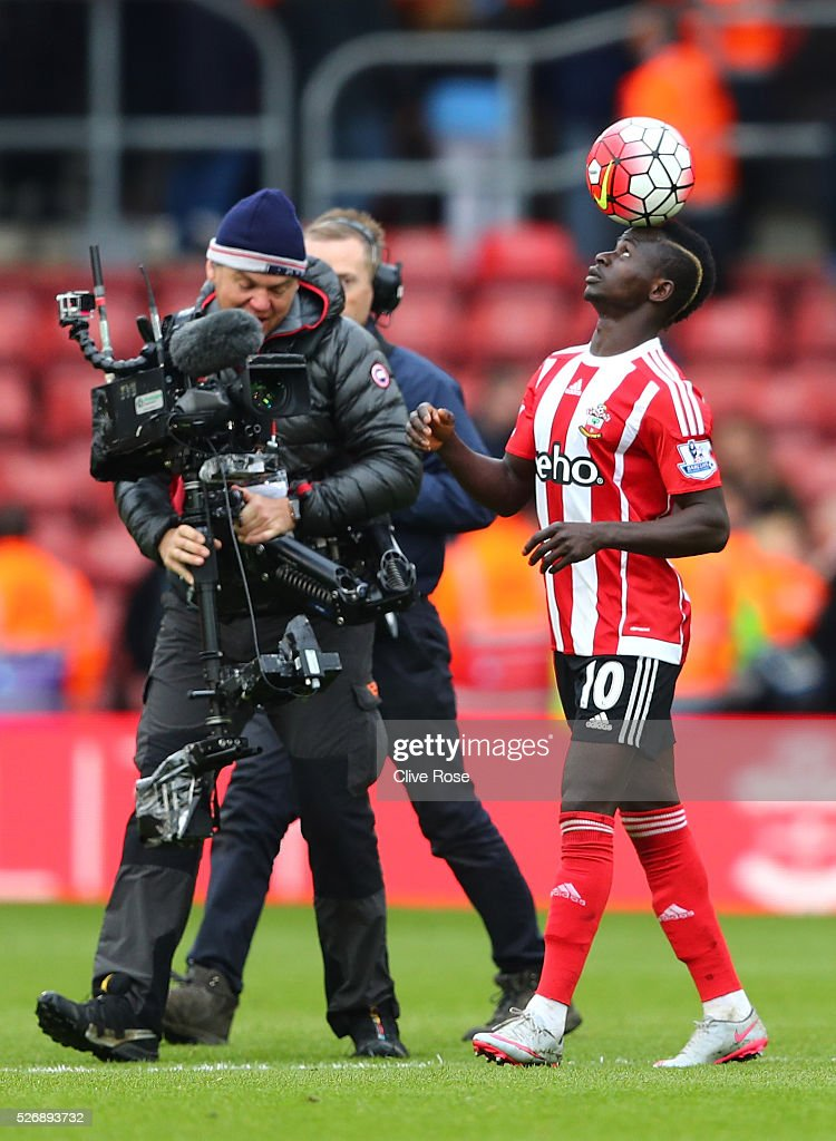 Sadio Mane of Southampton balances the ball after his hat trick during the Barclays Premier League match between Southampton and Manchester City at St Mary's Stadium on May 1, 2016 in Southampton, England.