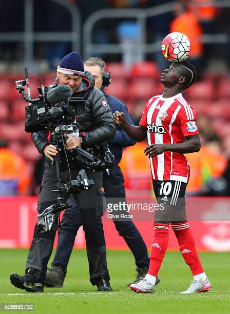 Sadio Mane of Southampton balances the ball after his hat trick during the Barclays Premier League match between Southampton and Manchester City at...