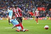 Sadio Mane of Southampton beats Aleksandar Kolarov of Manchester City as he scores his third goal and his team's fourth during the Barclays Premier...