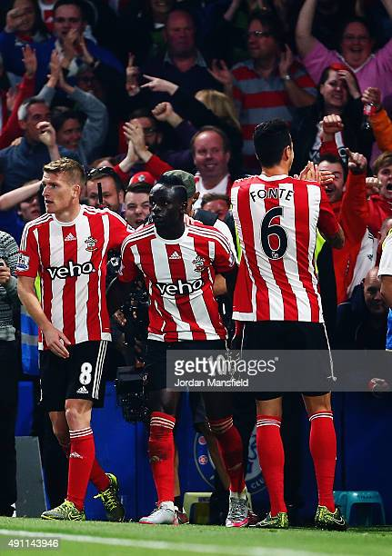 Sadio Mane of Southampton celebrates scoring his team's second goal with his team mates during the Barclays Premier League match between Chelsea and...