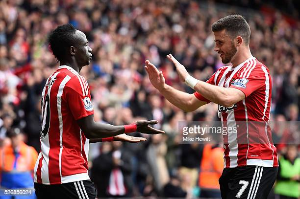 Sadio Mane of Southampton celebrates scoring his team's second goal with Shane Long during the Barclays Premier League match between Southampton and...