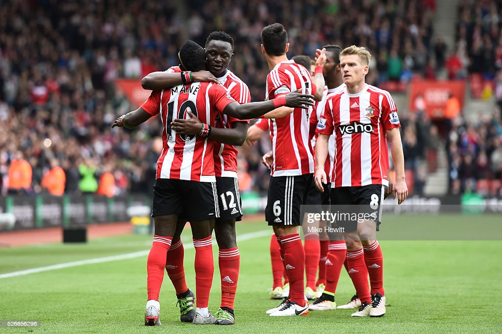 Sadio Mane (L) of Southampton celebrates scoring his team's second goal with Victor Wanyama during the Barclays Premier League match between Southampton and Manchester City at St Mary's Stadium on May 1, 2016 in Southampton, England.