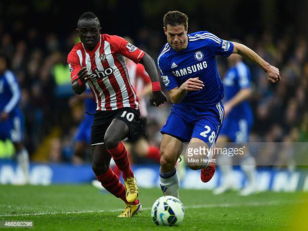Sadio Mane of Southampton challenges Cesar Azpilicueta of Chelsea during the Barclays Premier League match between Chelsea and Southampton at...