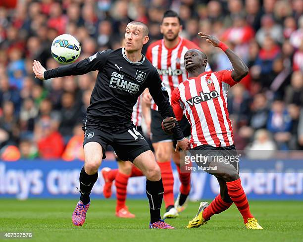 Sadio Mane of Southampton challenges David Jones of Burnley during the Barclays Premier League match between Southampton and Burnley at St Mary's...