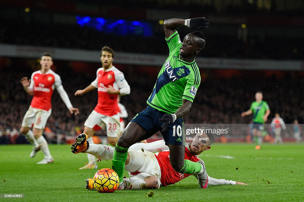Sadio Mane of Southampton is challenged by Gabriel of Arsenal during the Barclays Premier League match between Arsenal and Southampton at the Emirates Stadium on February 2, 2016 in London, England.