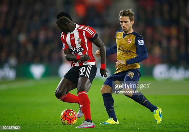 Sadio Mane of Southampton is wtahced by Nacho Monreal of Arsenal during the Barclays Premier League match between Southampton and Arsenal at St...
