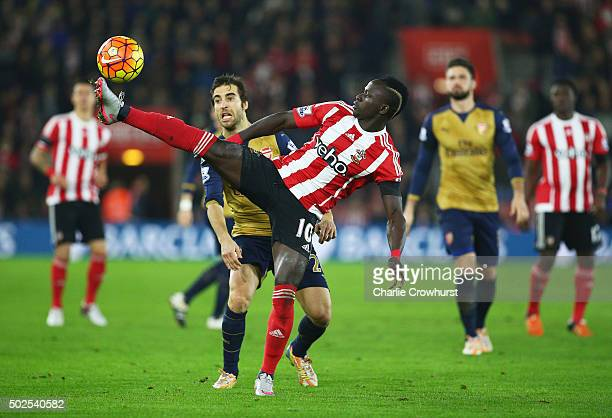 Sadio Mane of Southampton stretches for the ball ahead of Mathieu Flamini of Arsenal during the Barclays Premier League match between Southampton and...