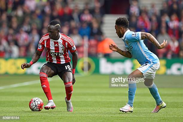 Sadio Mane of Southampton takes on Raheem Sterling of Manchester City during the Barclays Premier League match between Southampton and Manchester...