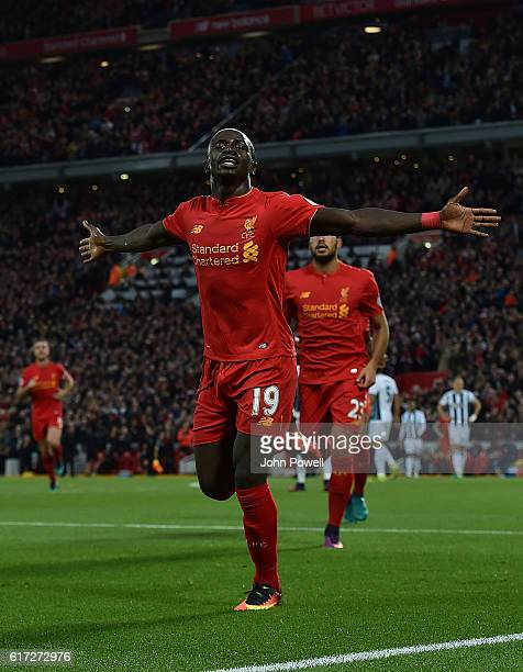 Sadio Mane Scores Liverpools Opener and celebrates during the Premier League match between Liverpool and West Bromwich Albion at Anfield on October...