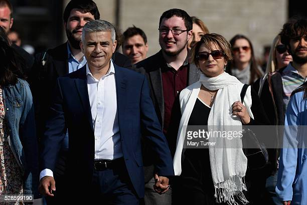 Sadiq Khan arrives with his wife Saadiya family and aides arrive at City Hall on May 6 2016 in London England Mr Khan is expected to be declared the...