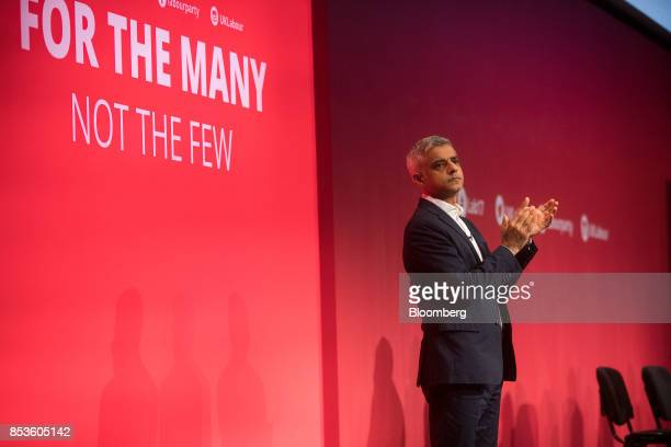 Sadiq Khan London mayor from the UK opposition Labour Party applauds supporters at the Labour Party Annual Conference in Brighton UK on Monday Sept...