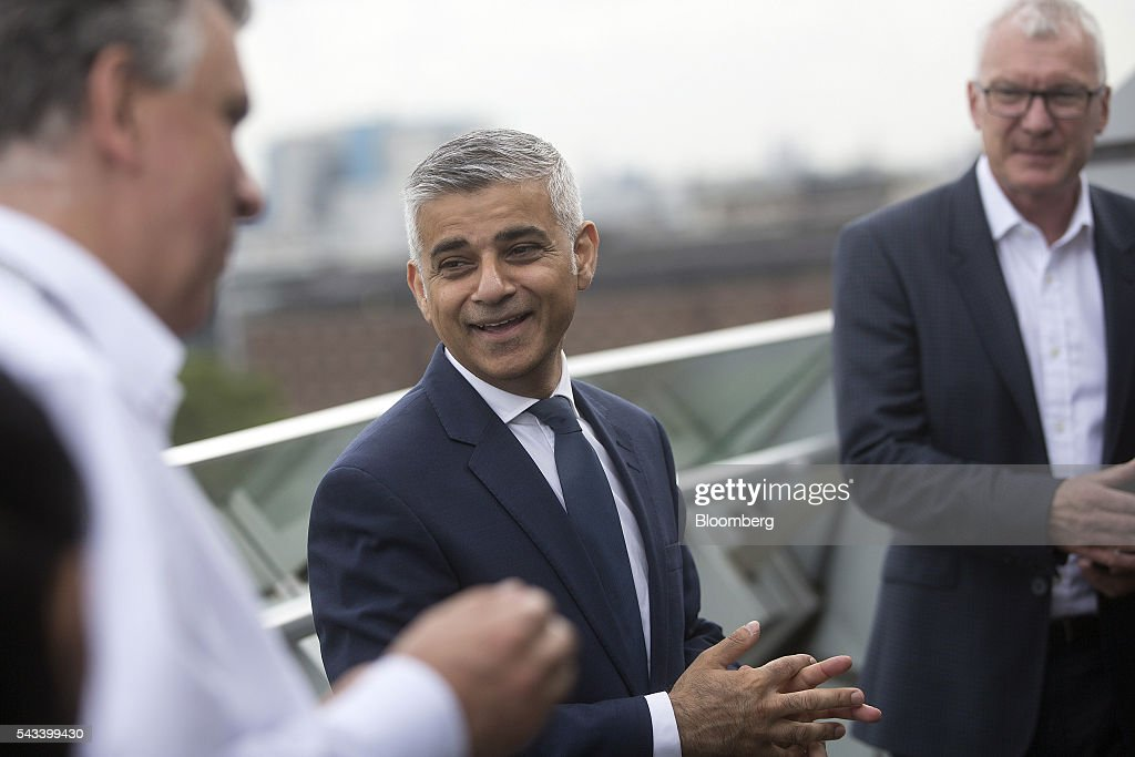 <a gi-track='captionPersonalityLinkClicked' href=/galleries/search?phrase=Sadiq+Khan&family=editorial&specificpeople=3431876 ng-click='$event.stopPropagation()'>Sadiq Khan</a>, mayor of London, centre, reacts following a Bloomberg Television interview at City Hall in London, U.K., on Tuesday, June 28, 2016. Khan, who campaigned for Britain to remain in the EU, issued a statement immediately after the result was announced on Friday to reassure almost 1 million EU citizens living in London that they are welcome in the city and recognizing the enormous contribution they make to its economy and civic and cultural life. Photographer: Simon Dawson/Bloomberg via Getty Images