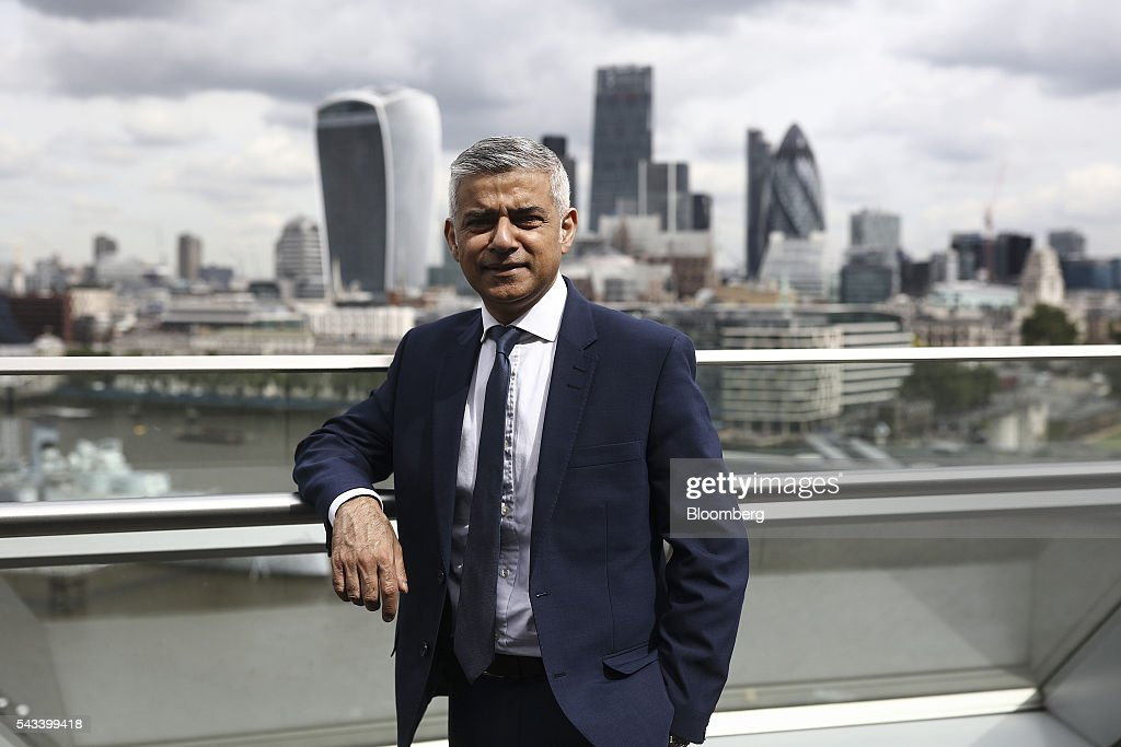 <a gi-track='captionPersonalityLinkClicked' href=/galleries/search?phrase=Sadiq+Khan&family=editorial&specificpeople=3431876 ng-click='$event.stopPropagation()'>Sadiq Khan</a>, mayor of London, poses for a photograph following a Bloomberg Television interview at City Hall in London, U.K., on Tuesday, June 28, 2016. Khan, who campaigned for Britain to remain in the EU, issued a statement immediately after the result was announced on Friday to reassure almost 1 million EU citizens living in London that they are welcome in the city and recognizing the enormous contribution they make to its economy and civic and cultural life. Photographer: Simon Dawson/Bloomberg via Getty Images