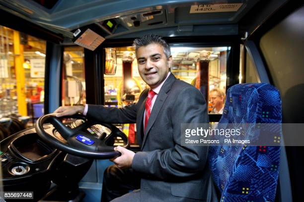 Sadiq Khan sits in the driving seat as he visits the Alexander Dennis Limited factory in Guildford Surrey
