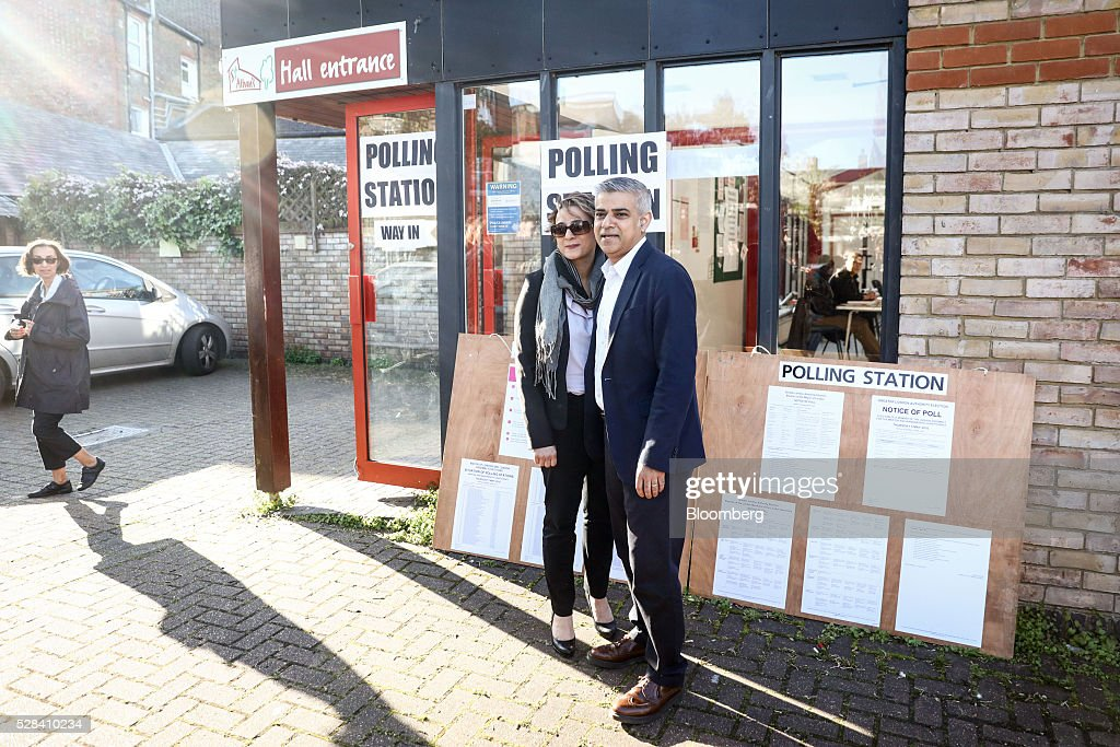 Sadiq Khan, the Labour Party candidate for London mayor, and his wife Saadiya Khan, pose for photographers after voting in the Mayor of London and London Assembly elections in London, U.K., on Thursday, May 5, 2016. Britain goes to the polls Thursday in a series of local and legislative elections that will deliver a new mayor for London, continued nationalist government in Scotland and the voters' first verdict on Jeremy Corbyn's leadership of the opposition Labour Party. Photographer: Simon Dawson/Bloomberg via Getty Images