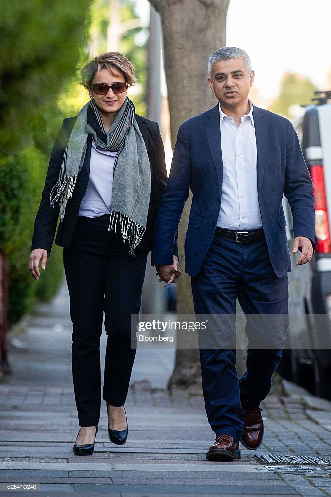 Sadiq Khan, the Labour Party candidate for London mayor, and his wife Saadiya Khan, arrive to vote in the Mayor of London and London Assembly elections in London, U.K., on Thursday, May 5, 2016. Britain goes to the polls Thursday in a series of local and legislative elections that will deliver a new mayor for London, continued nationalist government in Scotland and the voters' first verdict on Jeremy Corbyn's leadership of the opposition Labour Party. Photographer: Simon Dawson/Bloomberg via Getty Images