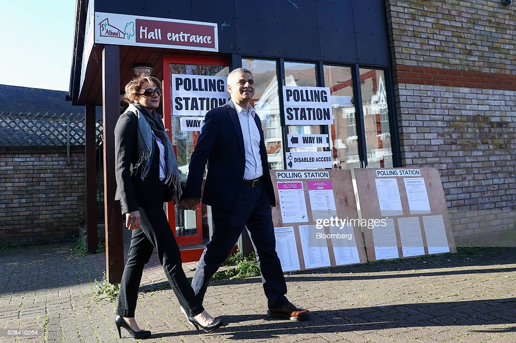 Sadiq Khan, the Labour Party candidate for London mayor, and his wife Saadiya Khan, exit a polling station after voting in the Mayor of London and London Assembly elections in London, U.K., on Thursday, May 5, 2016. Britain goes to the polls Thursday in a series of local and legislative elections that will deliver a new mayor for London, continued nationalist government in Scotland and the voters' first verdict on Jeremy Corbyn's leadership of the opposition Labour Party. Photographer: Simon Dawson/Bloomberg via Getty Images