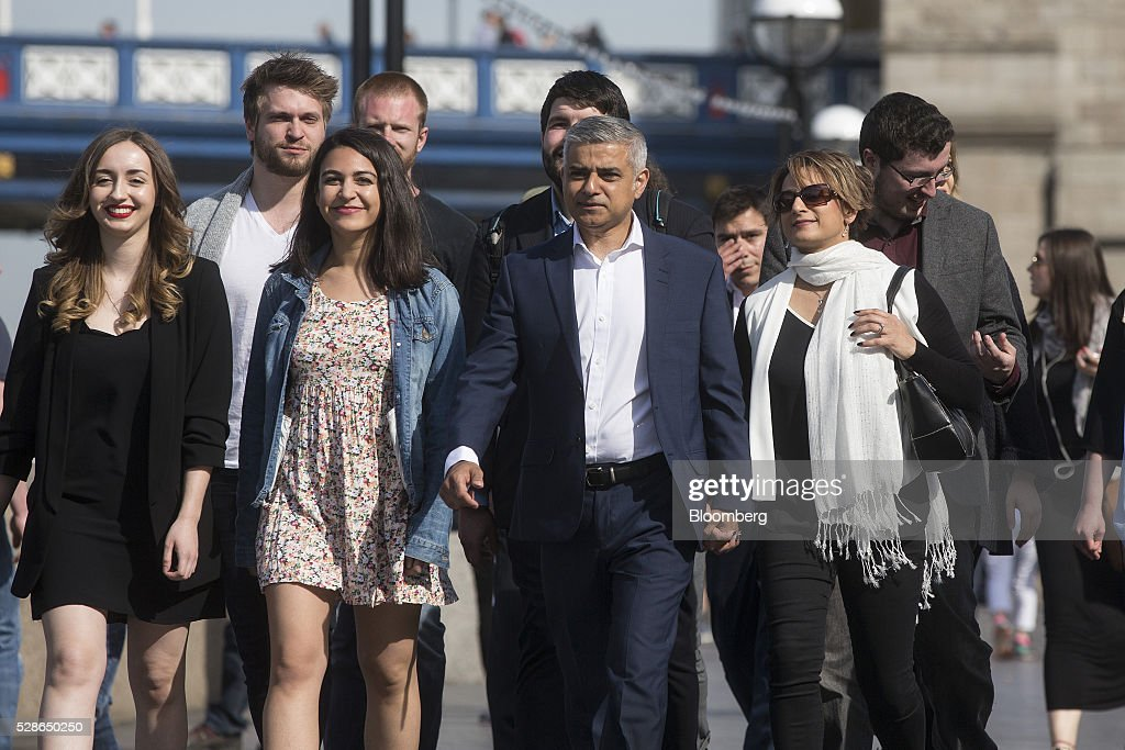 <a gi-track='captionPersonalityLinkClicked' href=/galleries/search?phrase=Sadiq+Khan&family=editorial&specificpeople=3431876 ng-click='$event.stopPropagation()'>Sadiq Khan</a>, the Labour Party candidate for London mayor, center, arrives with members of his team at City Hall in London, U.K., on Friday, May 6, 2016. Khan was in the lead after more than 90 percent of first preference votes had been counted on Friday, putting him on course to beat the Conservatives' Zac Goldsmith. Photographer: Simon Dawson/Bloomberg via Getty Images