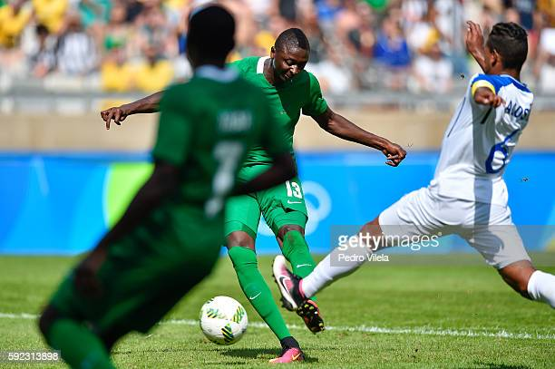 Sadiq UMAR of Nigeria and Bryan ACOSTA of Honduras battle for the ball during a match between Nigeria and Honduras as part of Men`s Football Olympics...