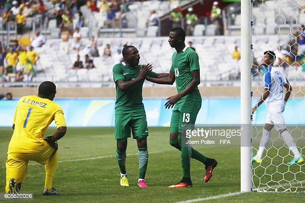 Sadiq Umar of Nigeria celebrates with his team mate Aminu Umar after scoring his team's first goal during the Men's Olympic Football Bronze Medal...