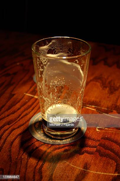 Sadness over empty pint of beer